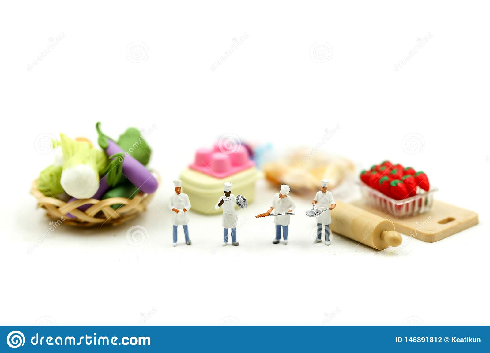Miniature people : Chef with Assortment of fresh fruits and vegetables,cooking concept