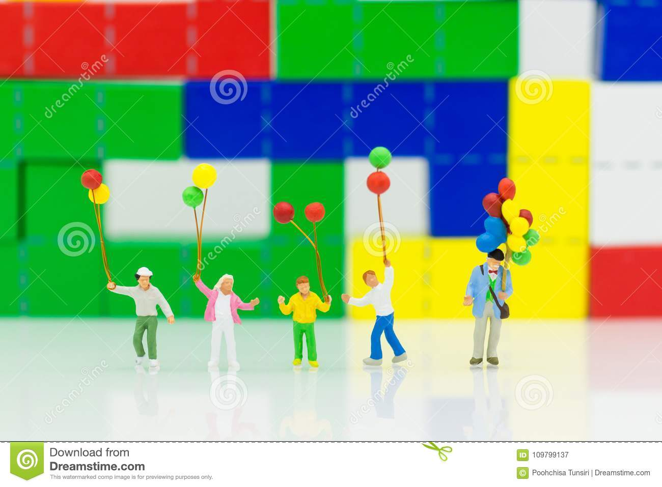 Miniature People: Children Holding A Balloon Front Of Wood Block ...