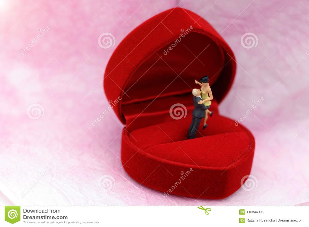Miniature People: Couple Standing On Red Wedding Ring Box. Stock ...