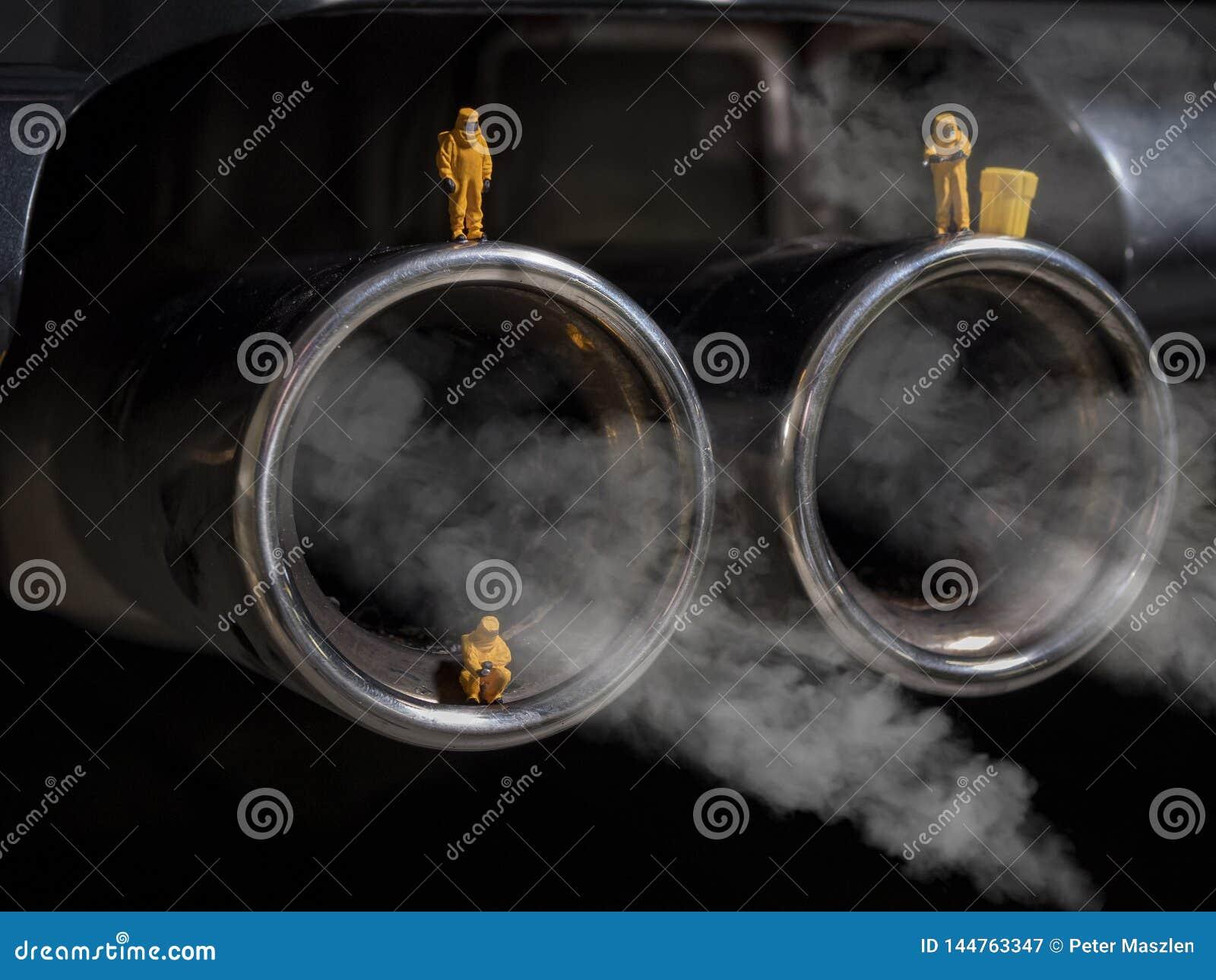 Miniature people examining car exhaust