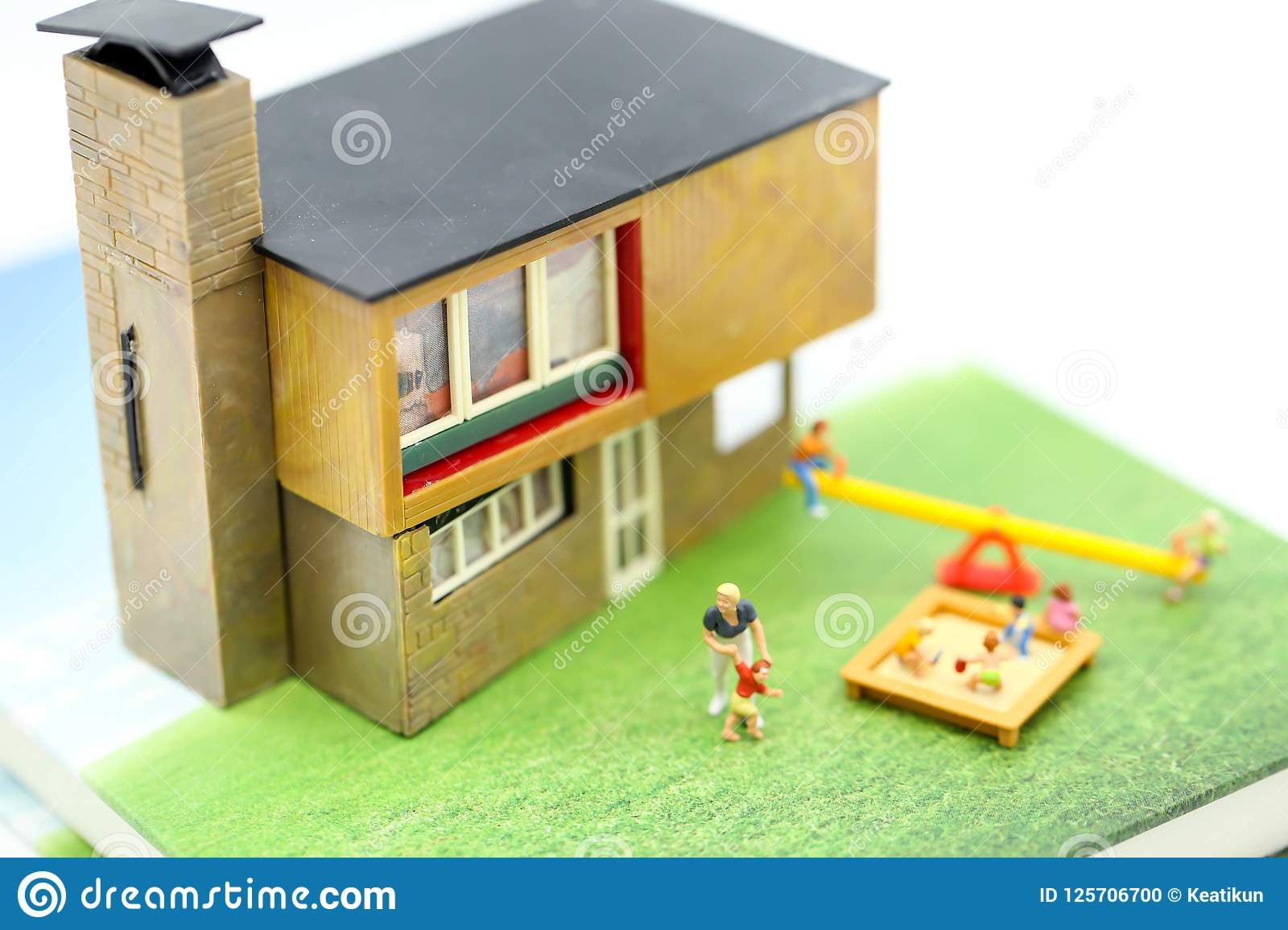 Miniature people : Family and children with house using for concept of step family day.