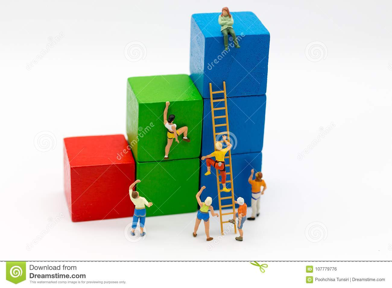 Miniature people : Group Athletes use stairs to climb colorful wood building. Image use for Activities, travel, business concept