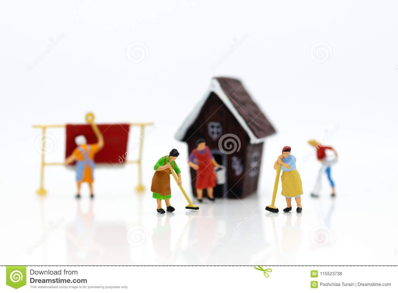 Miniature people: Housekeepers clean the house. Image use for cleaning occupations, business concept