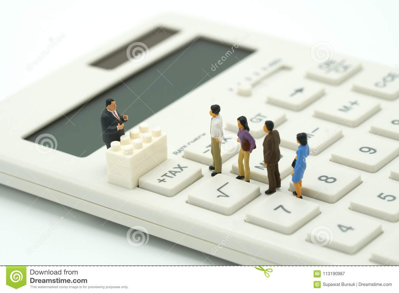 Miniature people Pay queue Annual income TAX for the year on calculator. using as background business concept and finance concep