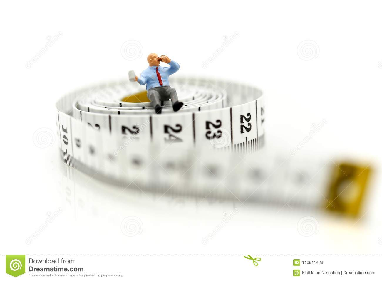 Miniature people people sitting with measuring tape of the tai royalty free stock photo ccuart Gallery