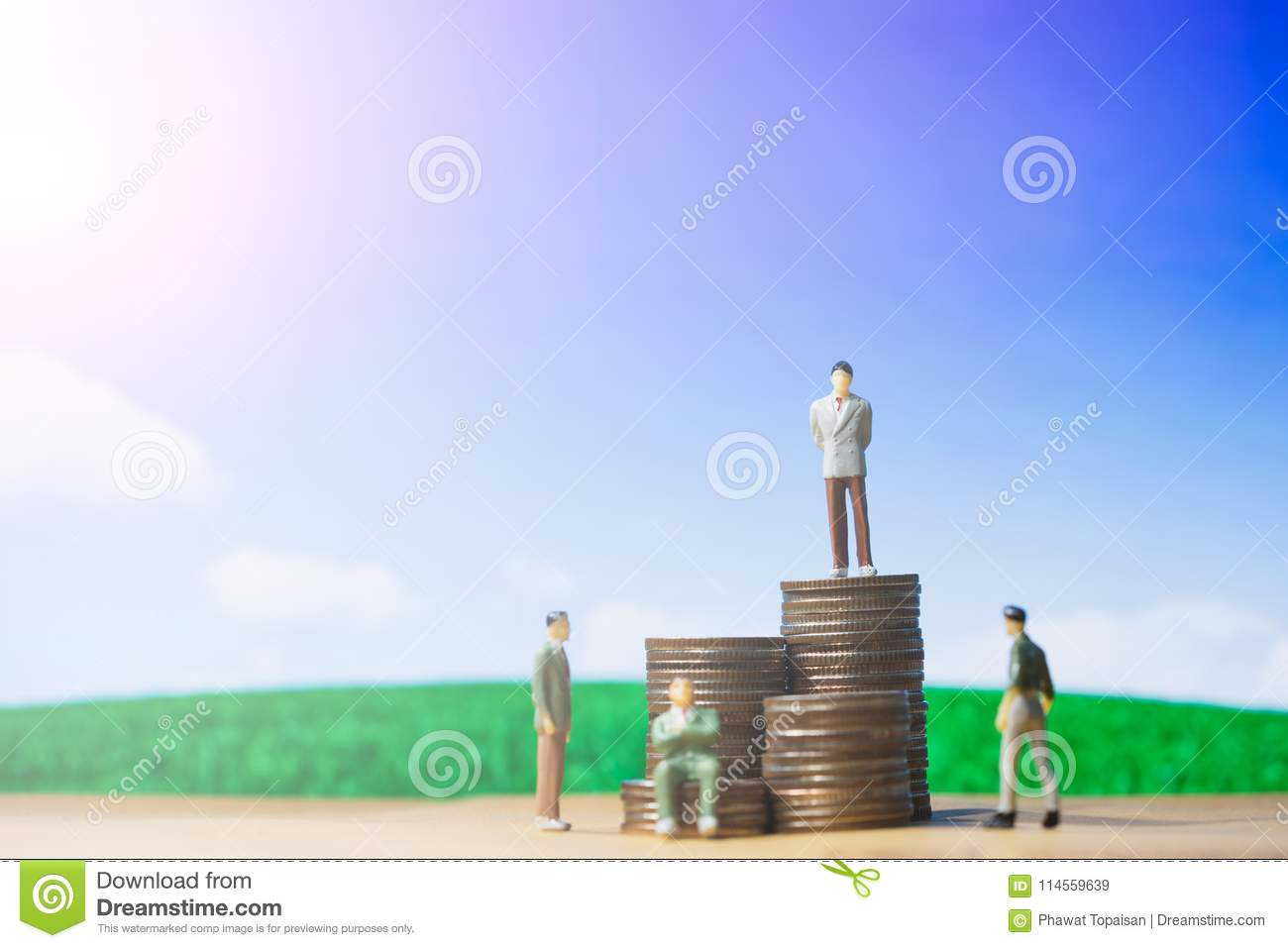 Miniature people small figures businessman stand on money of coin stack step up growing growth on blue sky and white cloud