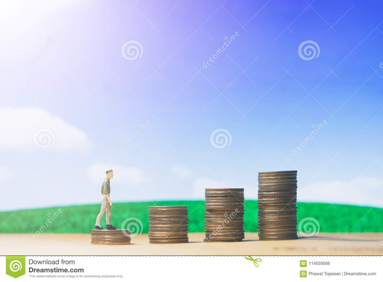 Miniature people small figures businessman walking on money of coin stack step up growing growth on blue sky and white cloud.