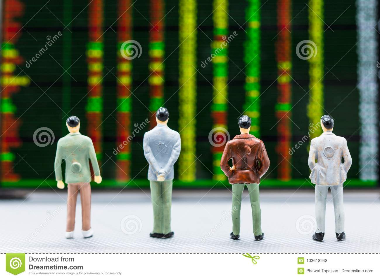 Businessmen stand and look at Stock Exchange Board Background