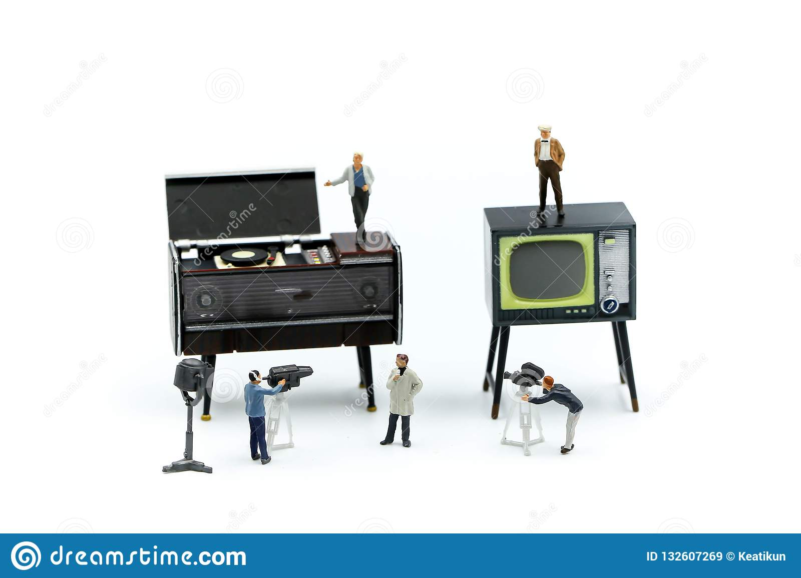 Miniature people : the small team of tv reporter of Audio Speakers, production television concept.