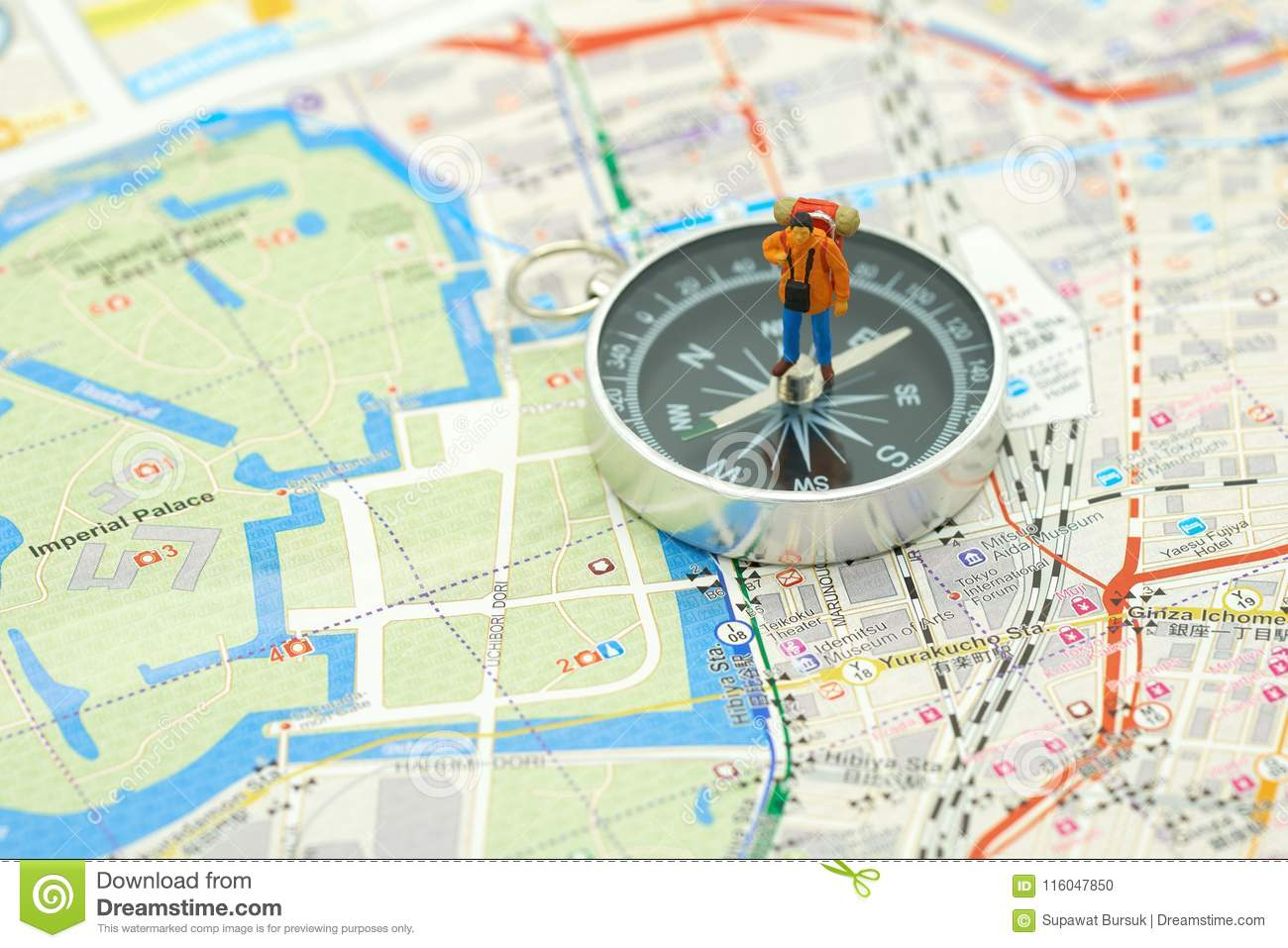 Miniature people standing travel planner on a compass with Japan map using as background travel concept with copy spaces and whit