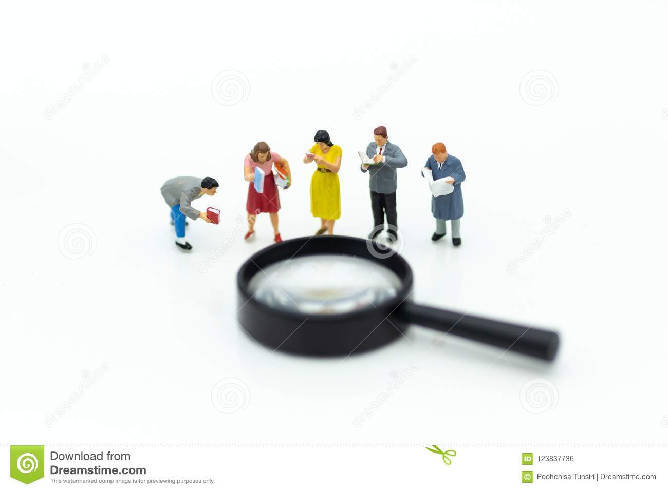 Miniature people: Students read books with magnifying glass . Image use for education concept