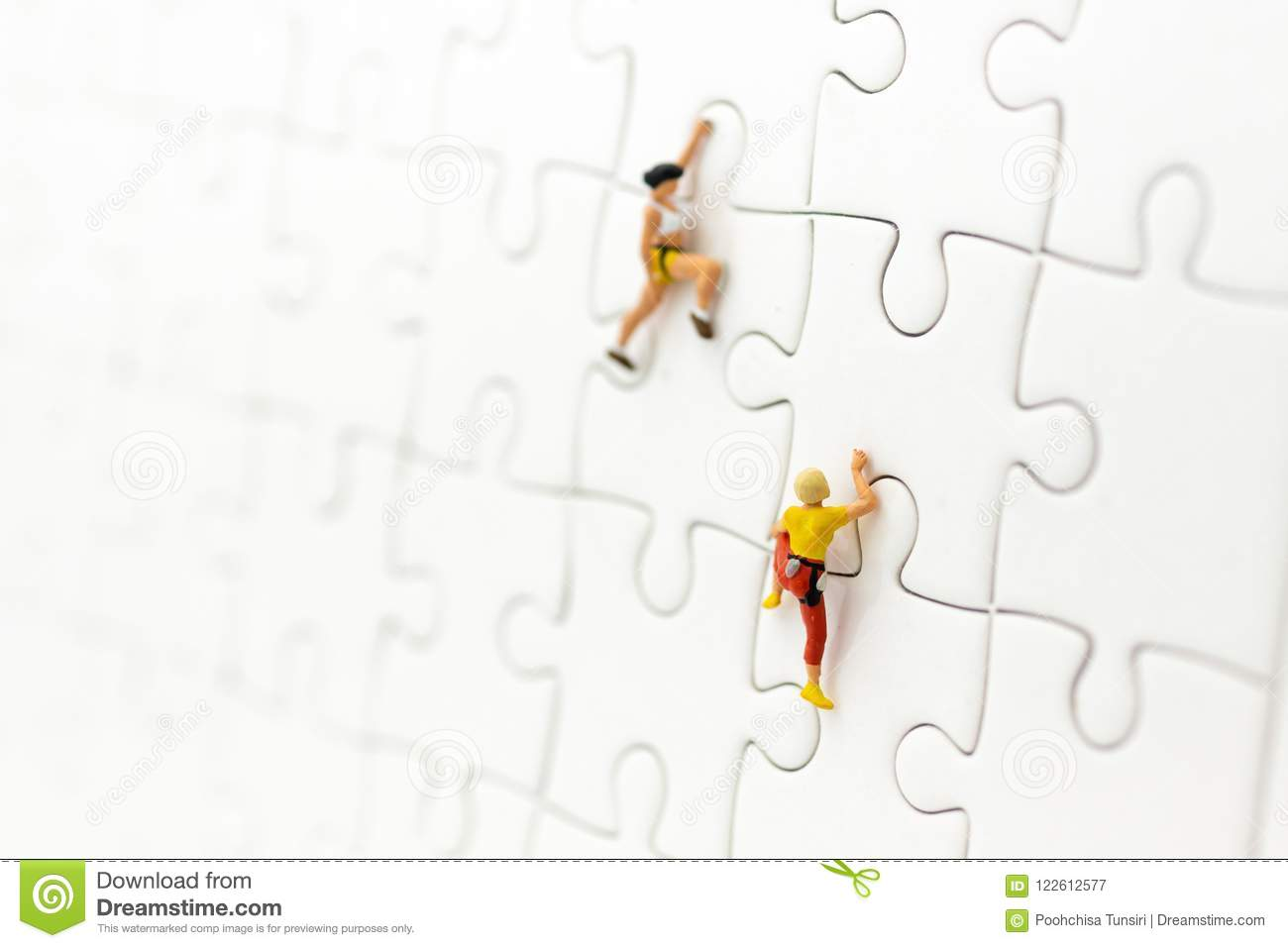 Miniature people : Traveler, climber on jigsaw board. Image use for to solve problems, finding solution and think new idea concept