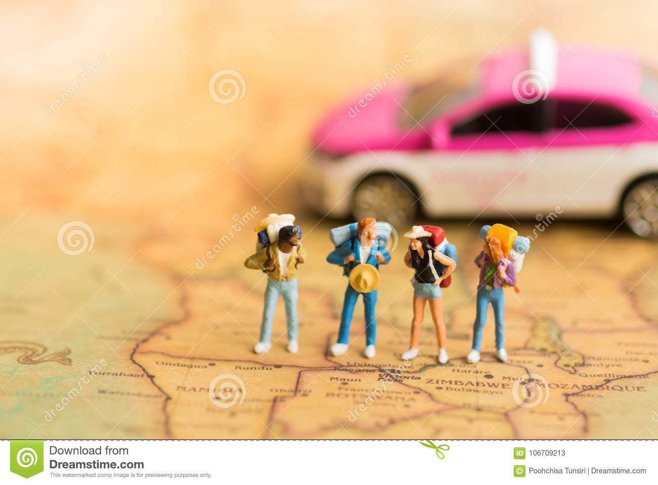 Miniature people travelers with backpack standing on world map download miniature people travelers with backpack standing on world map travel by taxi used gumiabroncs Images