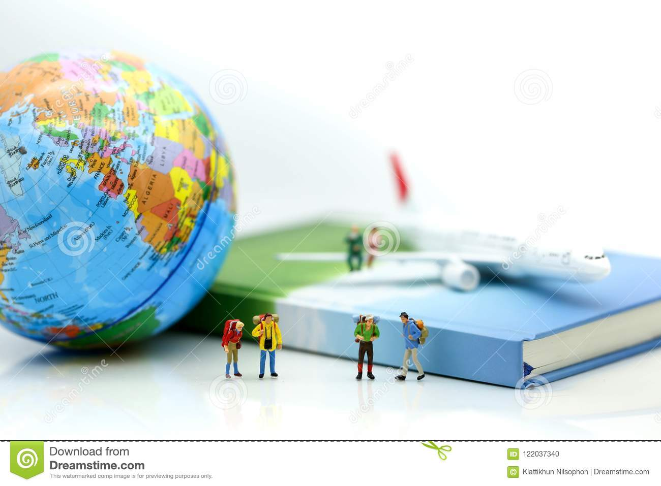 Miniature people : Travelers with world globe and airplane , traveling or exploring the world, relax travel concepts.