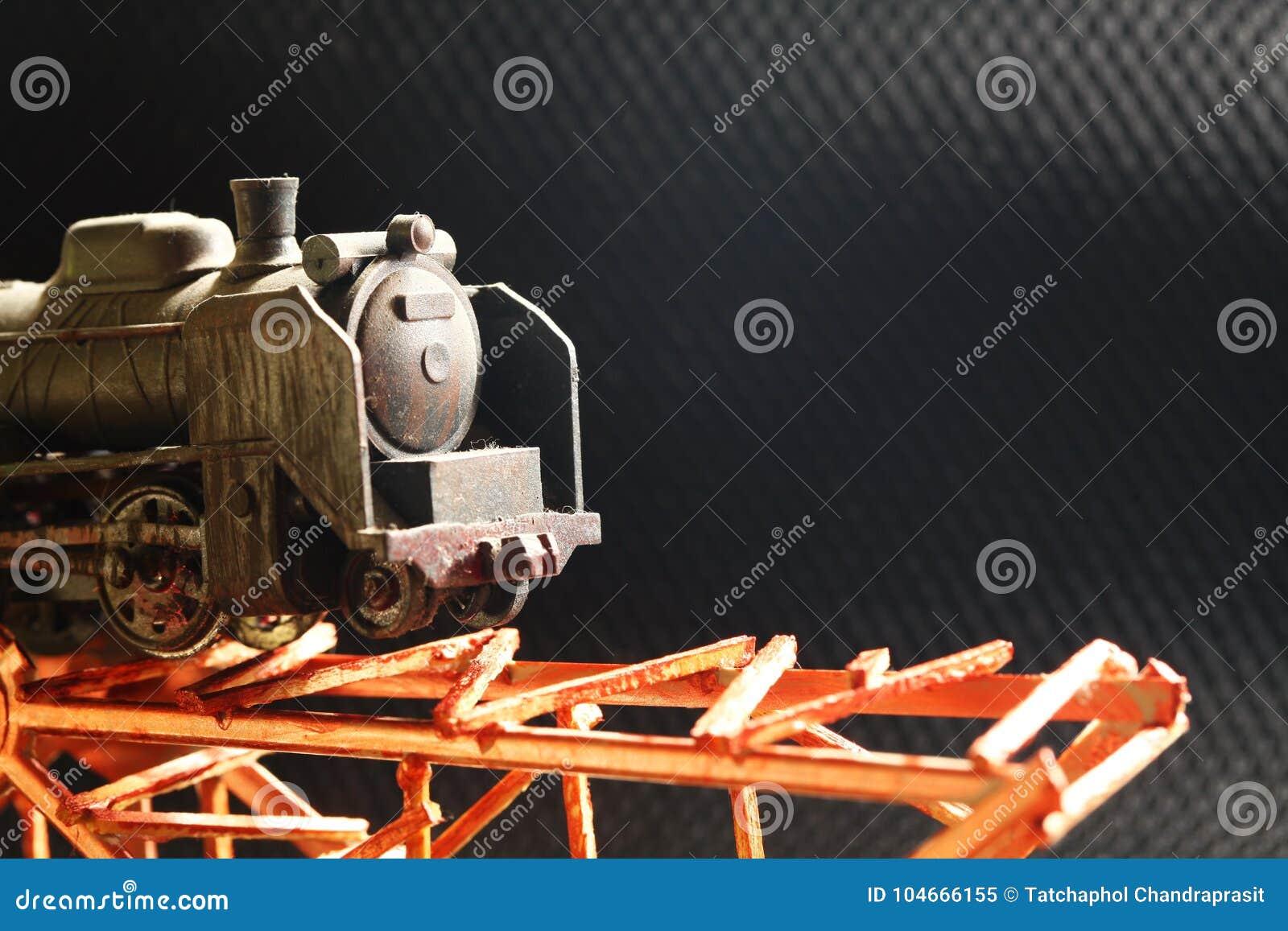 The miniature plastic model railroad on bridge.