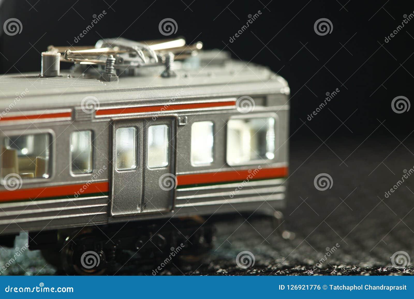 Miniature railroad model scene.