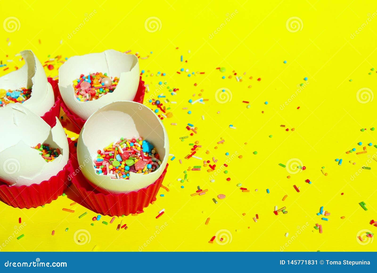 Minimal Art Design. Desserts, Holidays, Birthday Concept. Broken Eggs And Colorful Candies.