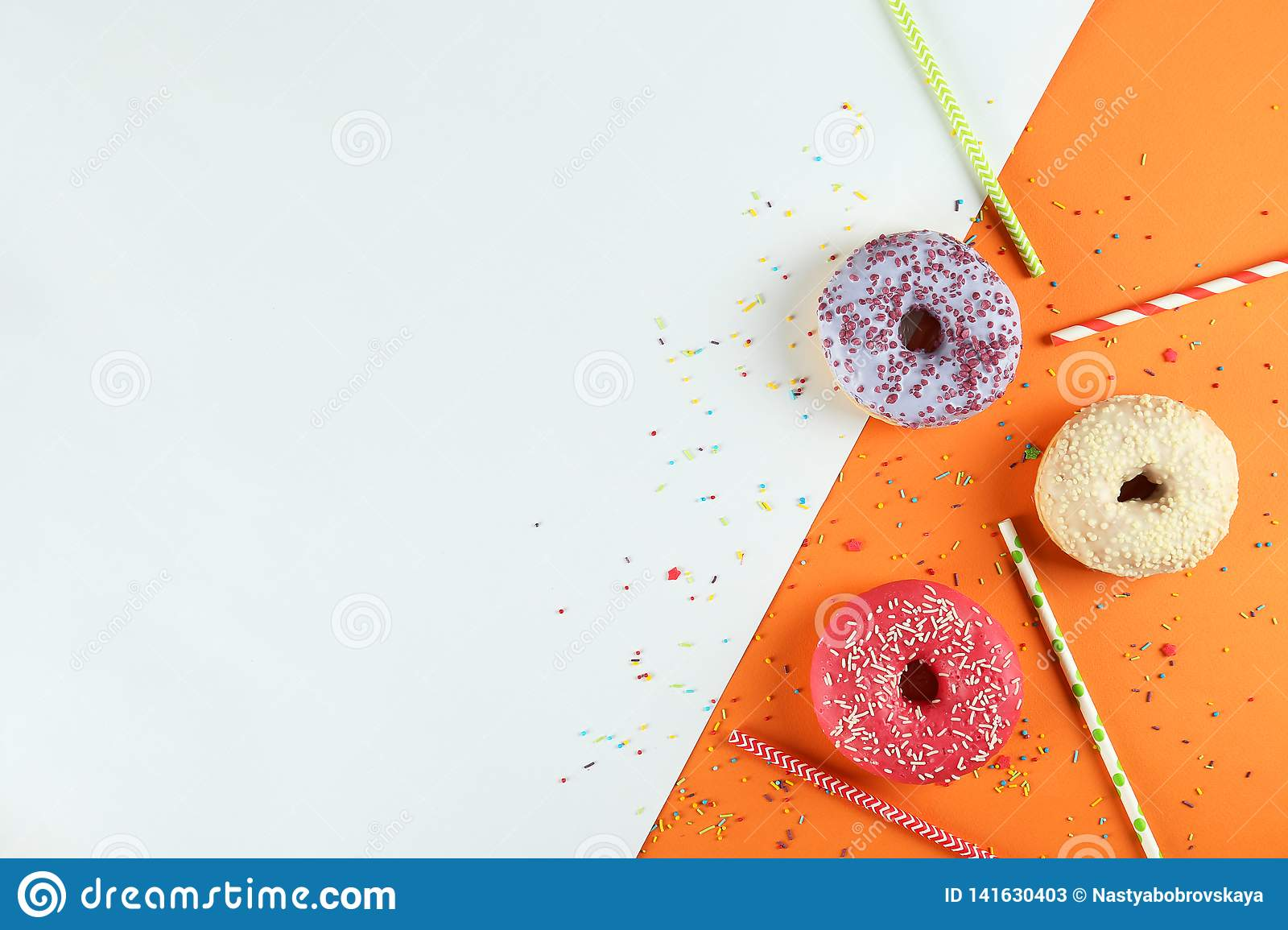 Minimal composition in vibrant colors with bright glaze donuts