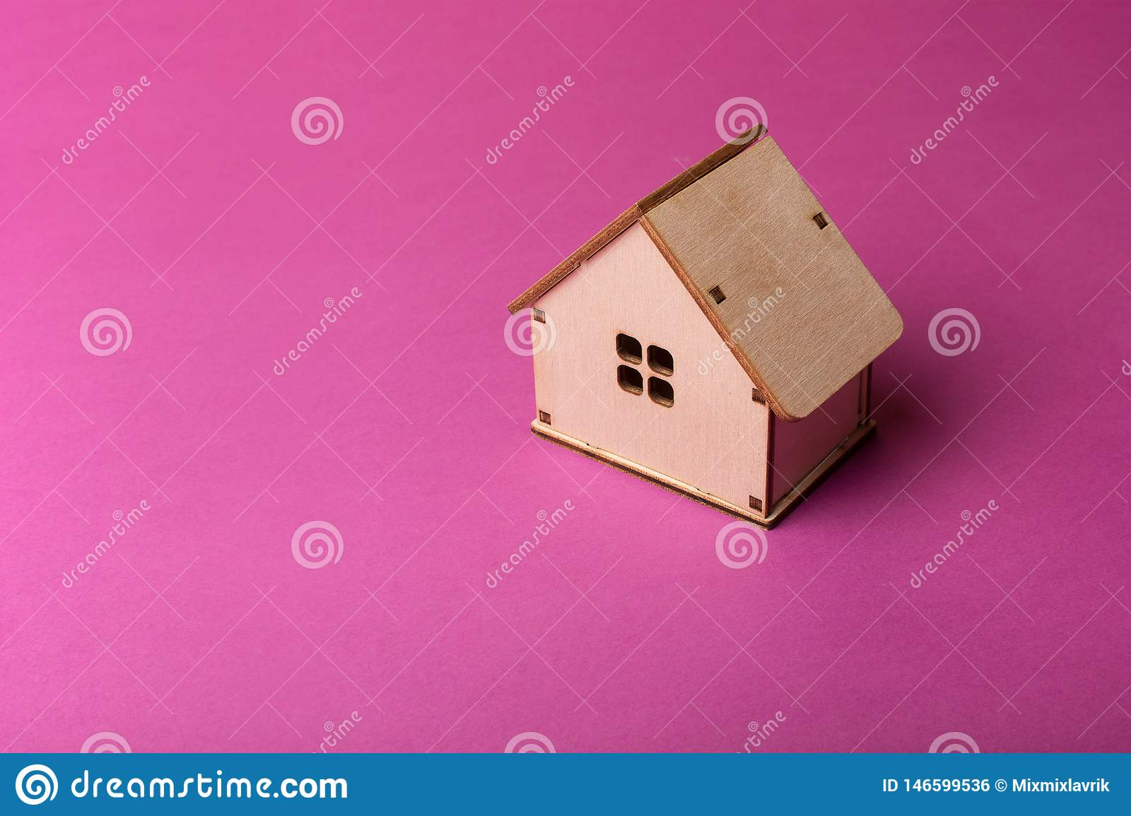 Minimal design with miniature wood toy house.