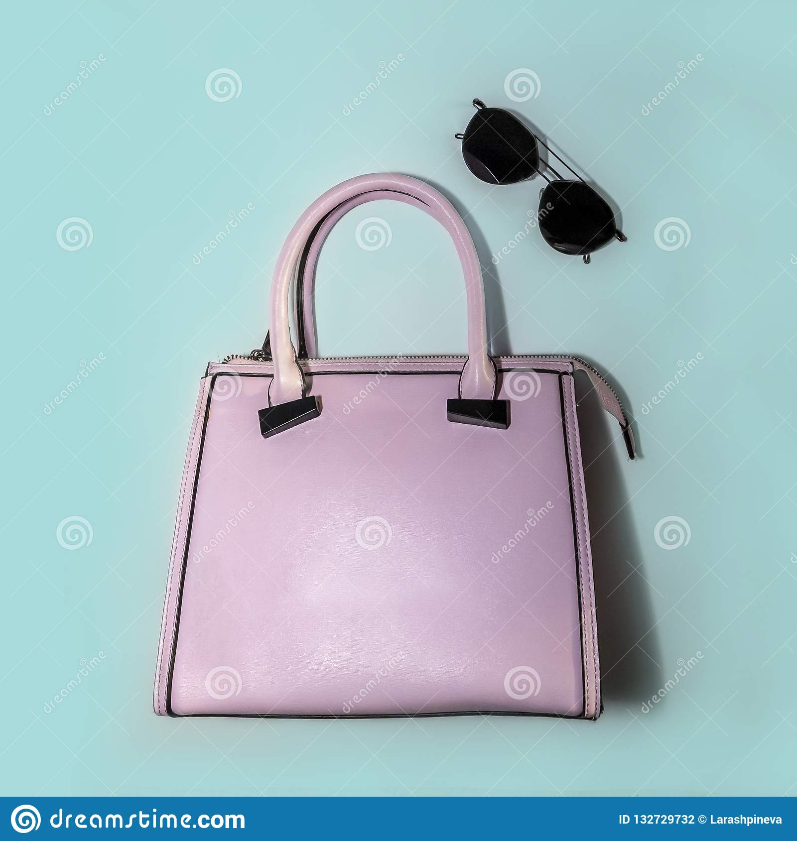 d813750762 Minimal fashion concept woman accessories - trendy summer sunglasses and glamour  pink handbag