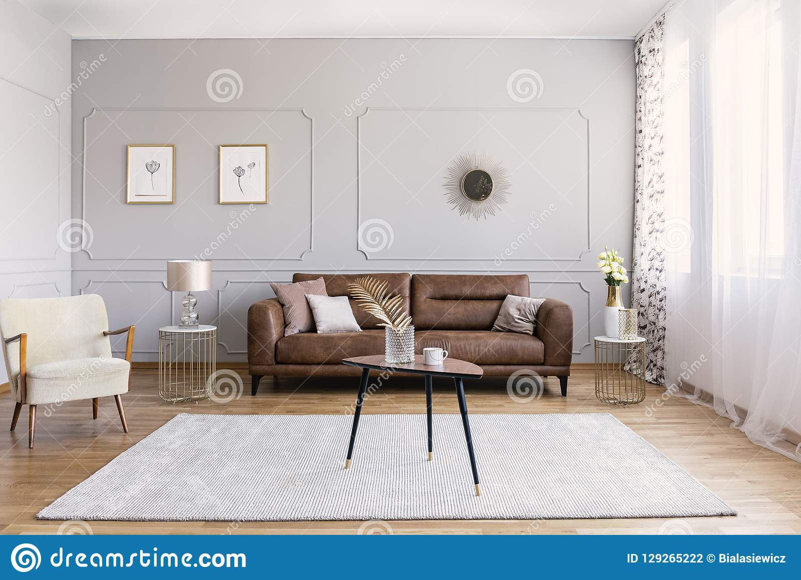 Minimal Interior Design Of Living Room With Brown Leather