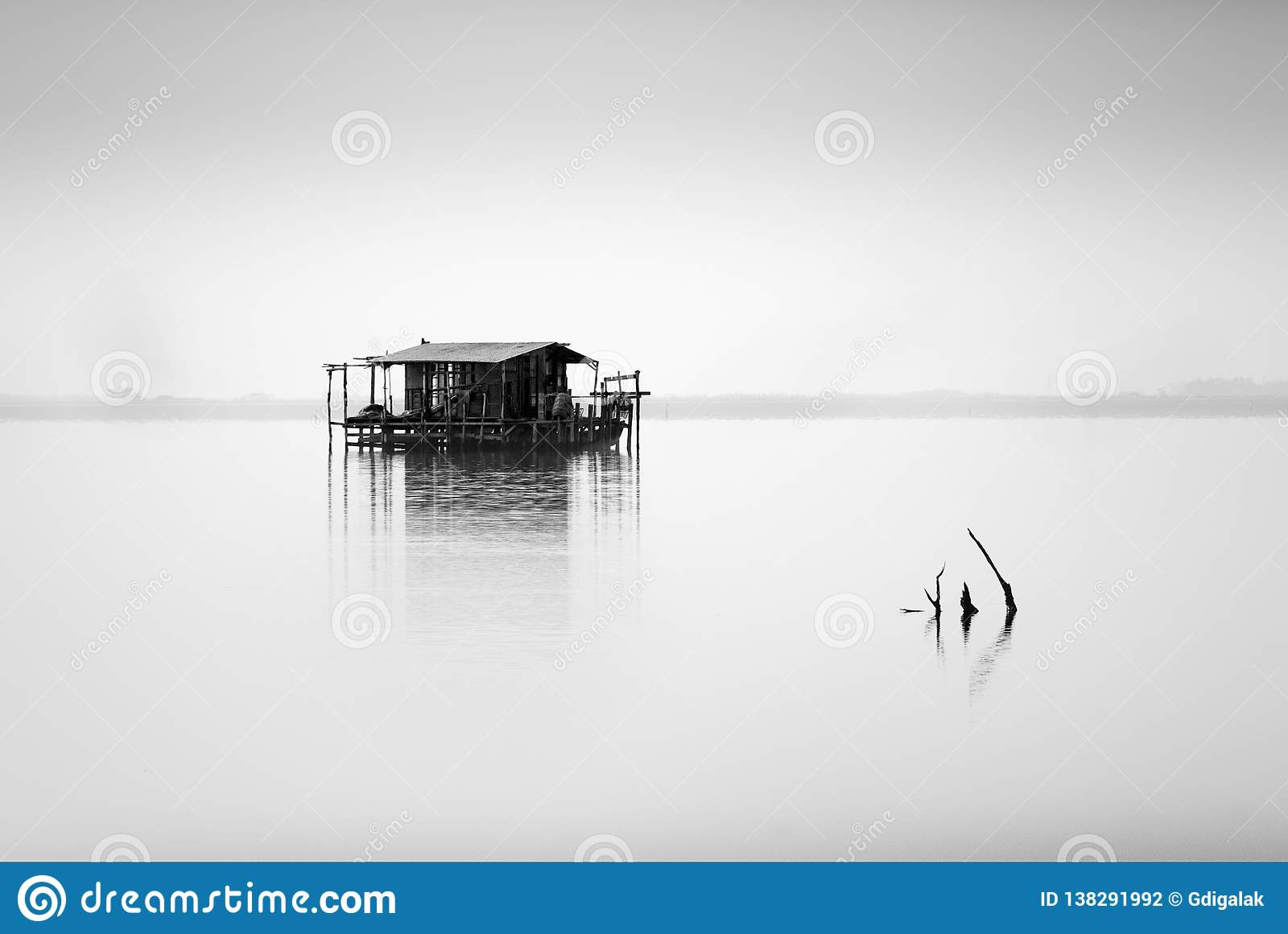 Minimal seascape with fishing hut