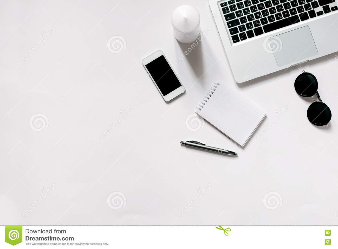 Notepad Pen Laptop And Cell Phone With Copy Space Stock