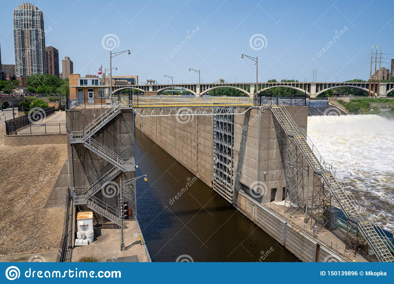 Minneapolis, Minnesota - June 1, 2019: View of the Upper St. Anthony Falls Lock and Dam along the Mississippi River in downtown