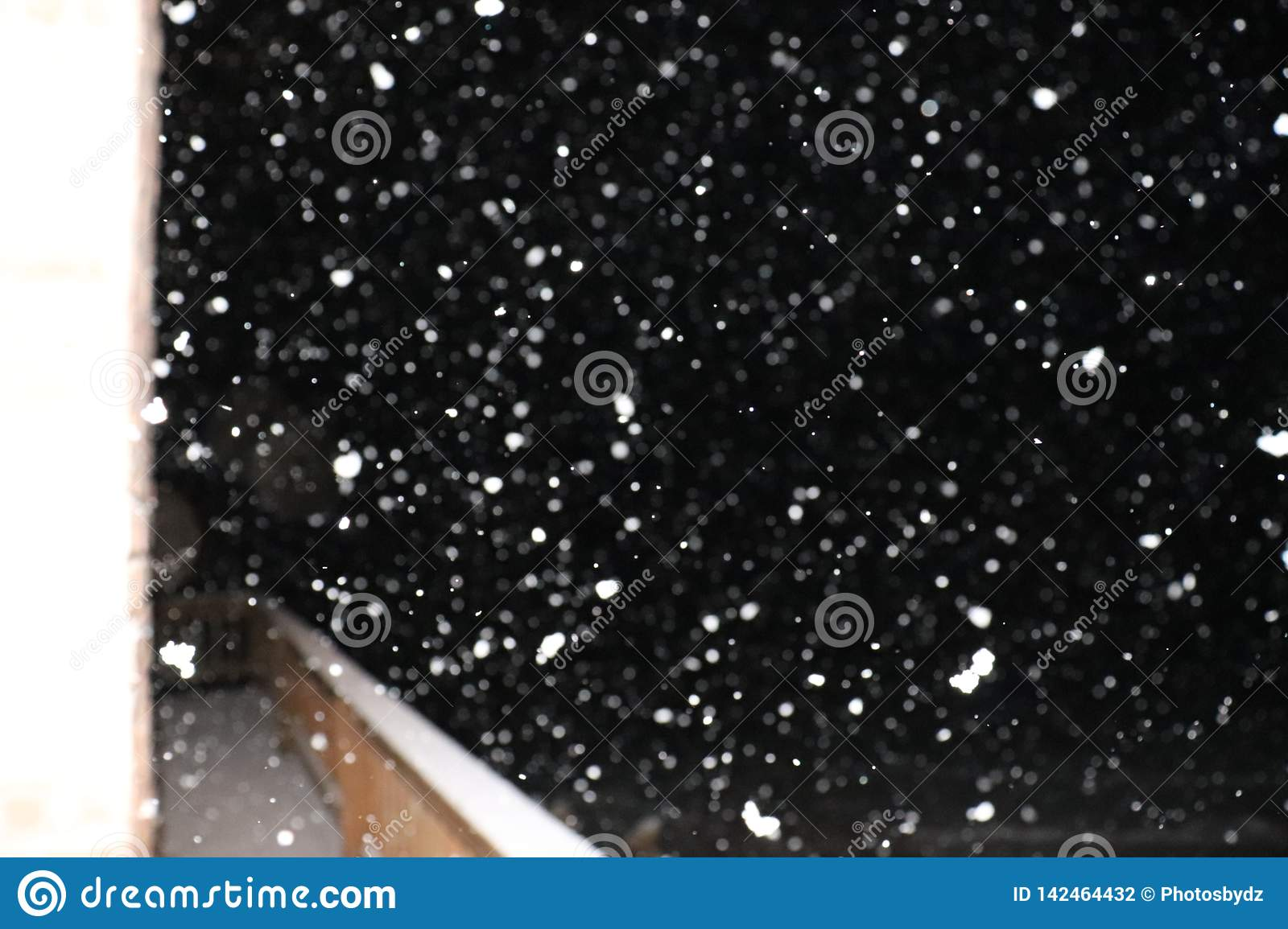 Snow Falling over a Deck
