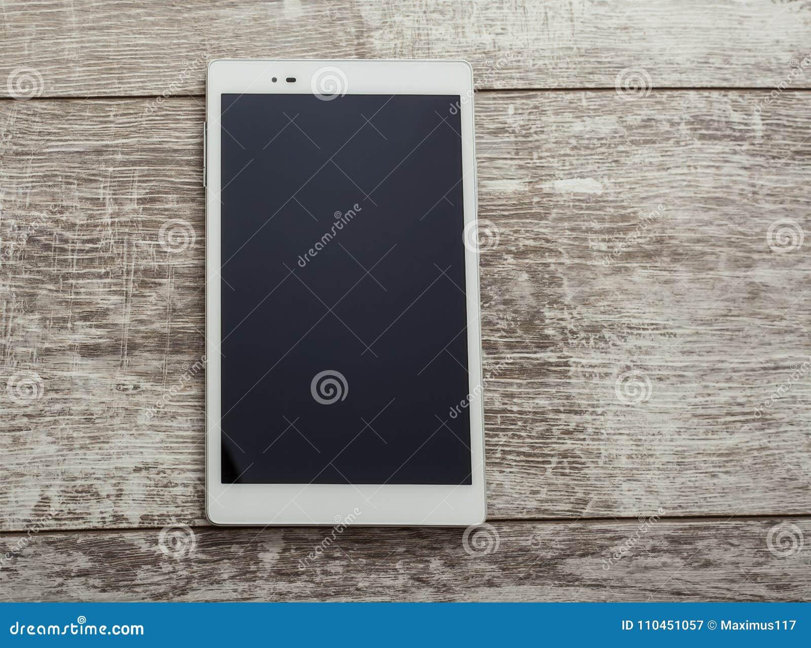 MinnestavlaPC på en wood tabell