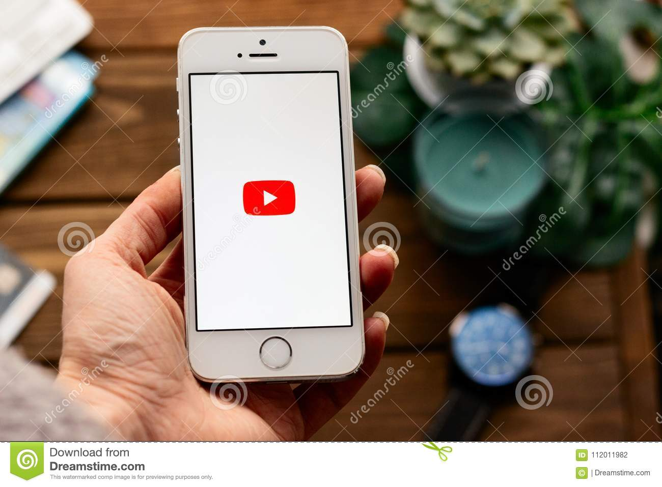 Hand With Apple Smartphone With Youtube Logo App Flat Lay With