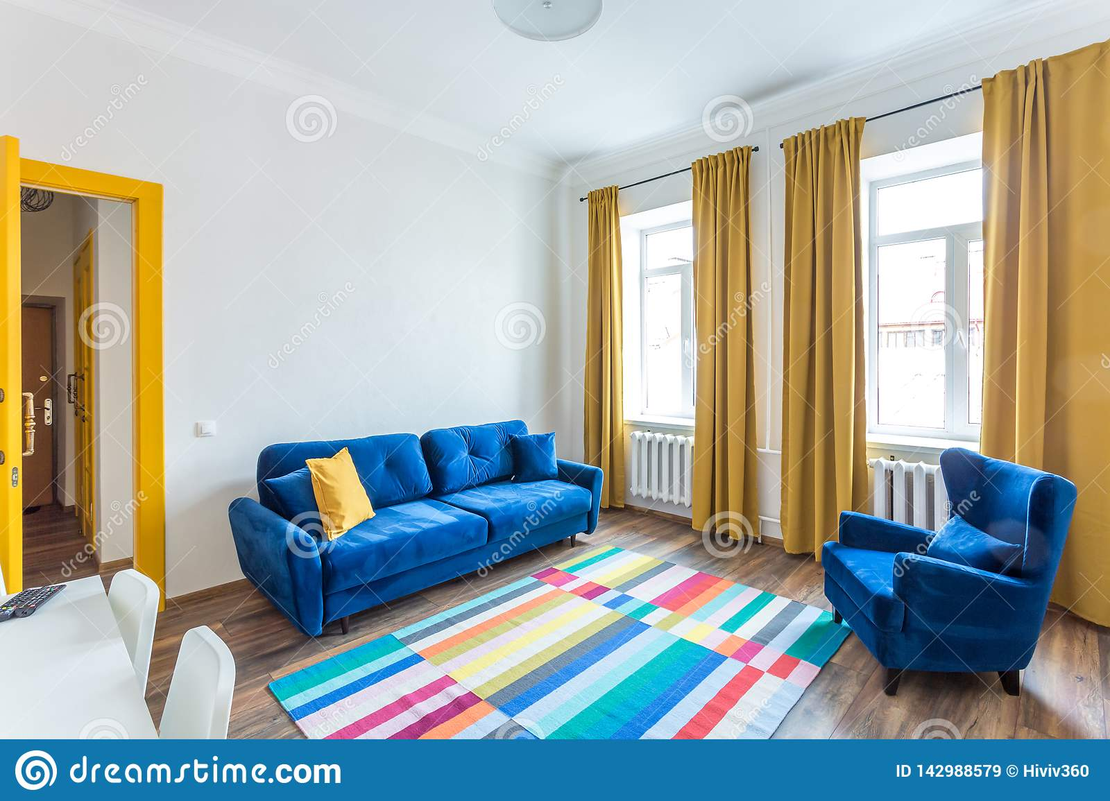 Minsk Belarus March 2019 Retro Bright Interior Of Hipster Flat Apartments With Blue Sofa Yellow Door And Colored Carpet Editorial Stock Image Image Of Hippy Indoor 142988579
