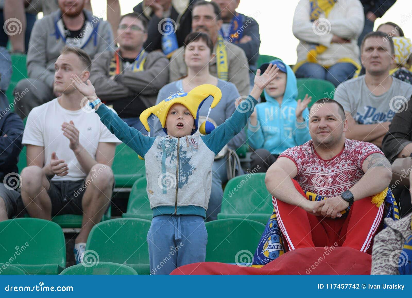 MINSK, BELARUS - MAY 23, 2018: Little fan having fun during the Belarusian Premier League football match between FC Dynamo Minsk a