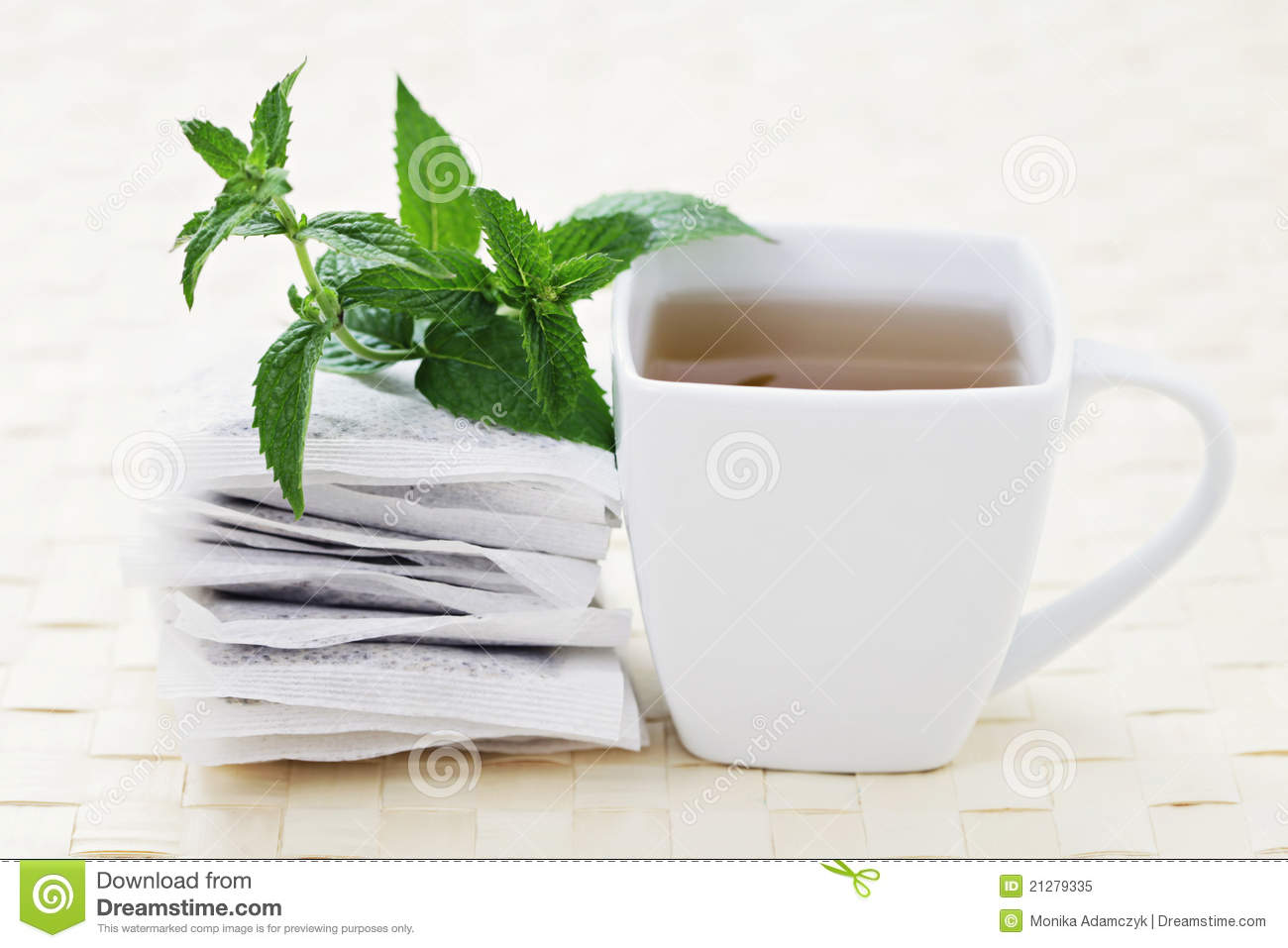 Cup of mint tea with fresh leaves - tea time /shallow DOF on mint/.