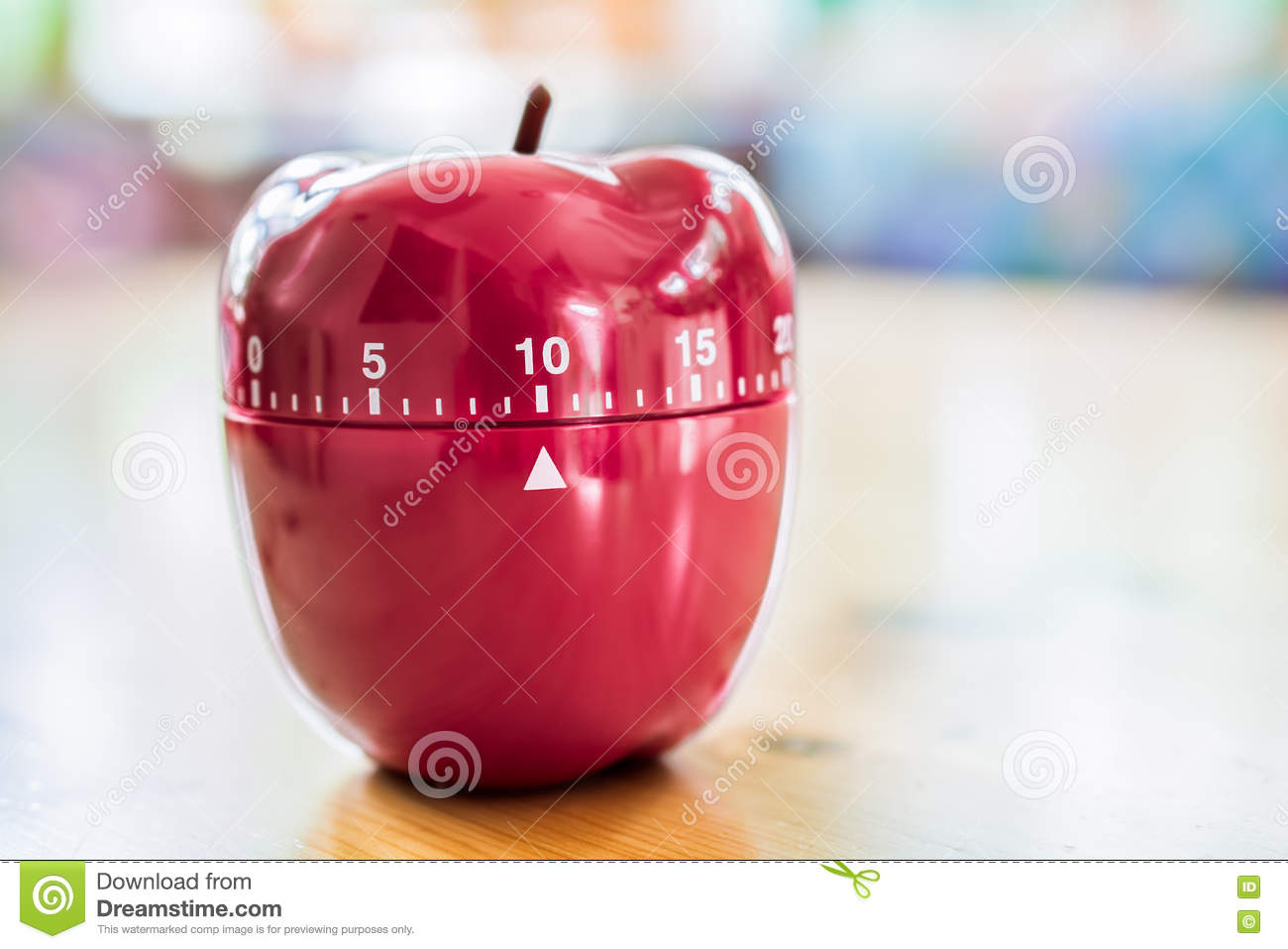 10 Minutes - Kitchen Egg Timer In Apple Shape On Wooden Table Stock