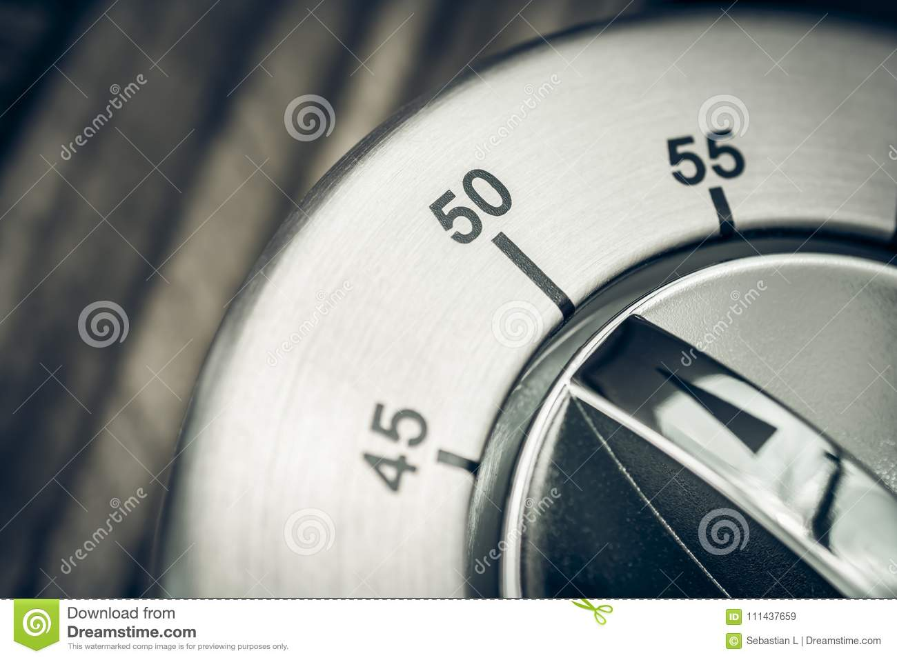 50 Minutes - Macro Of An Analog Chrome Kitchen Timer On Wooden T