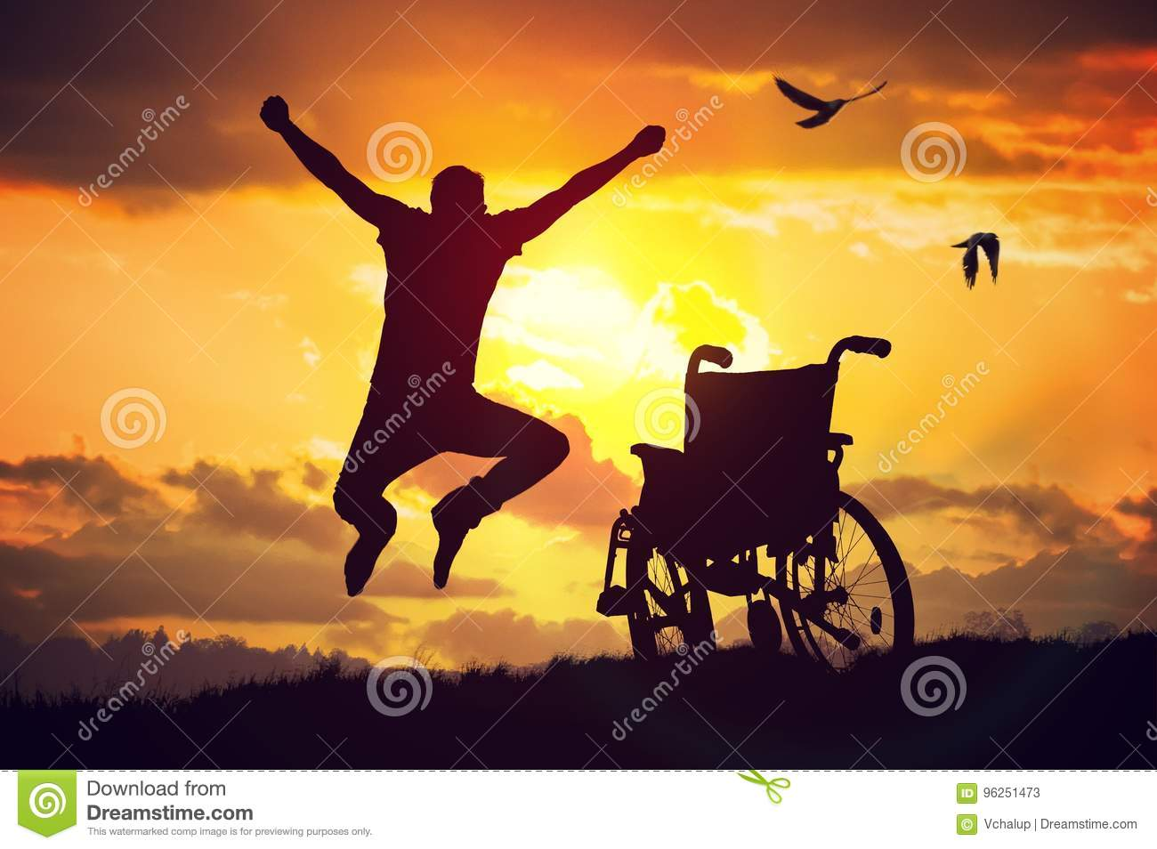 A miracle happened. Disabled handicapped man is healthy again. He is happy and jumping at sunset