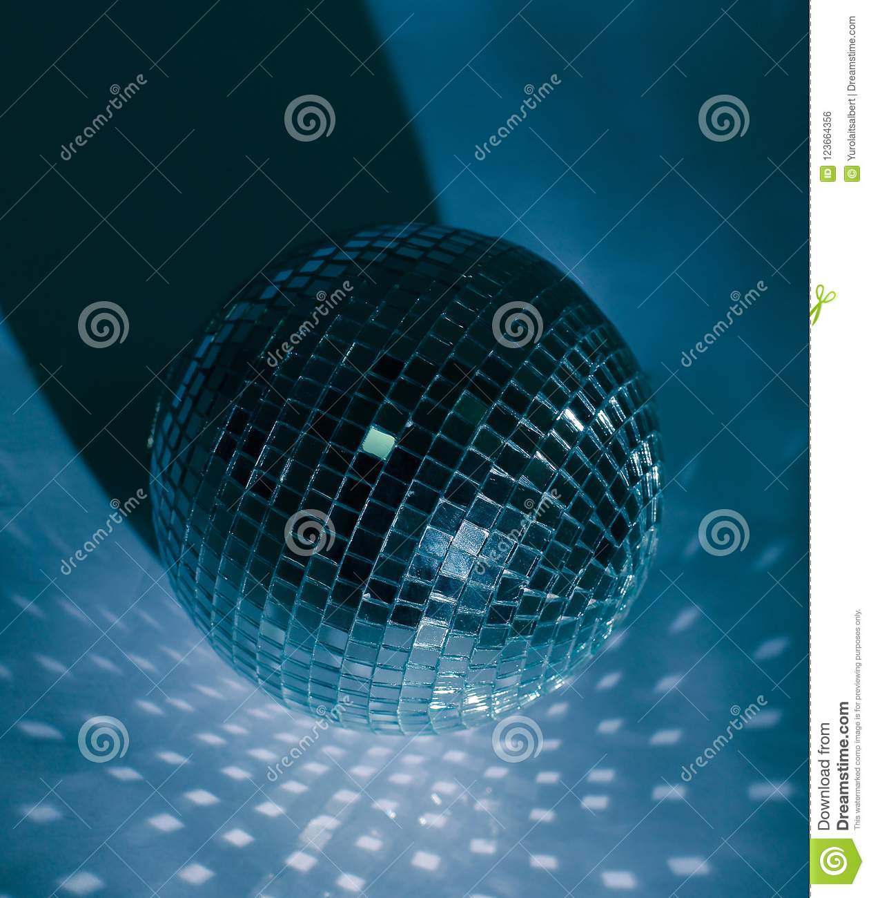 Mirror Ball Isolated On A Dark Background With Blue Backlight Stock