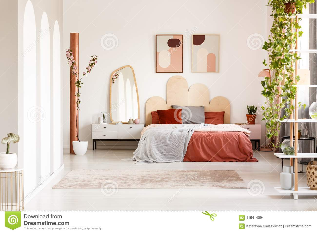 Mirror On Cabinet Next To Orange Bed Under Posters In ... on Mirrors Next To Bed  id=39246