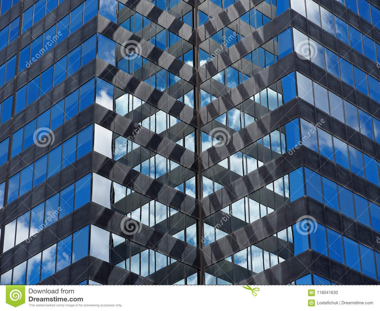 Mirror Glass And Steel Building With Reflection