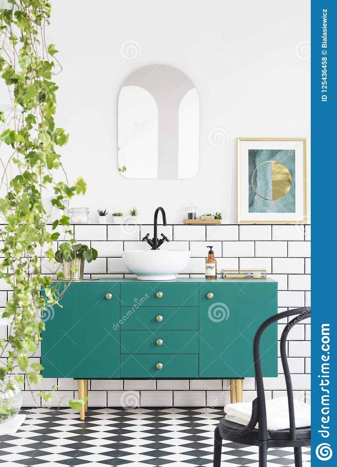 Mirror And Poster Above Green Cabinet In Bathroom Interior With Black Chair And Plants Real Photo Stock Photo Image Of Poster Contrast 125436458
