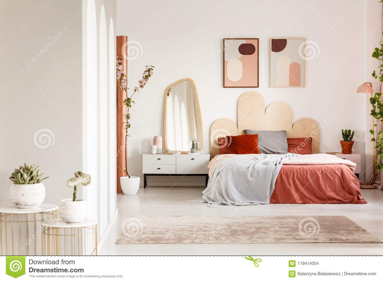Mirror On White Cabinet Next To Orange Bed Under Posters ... on Mirrors Next To Bed  id=34807