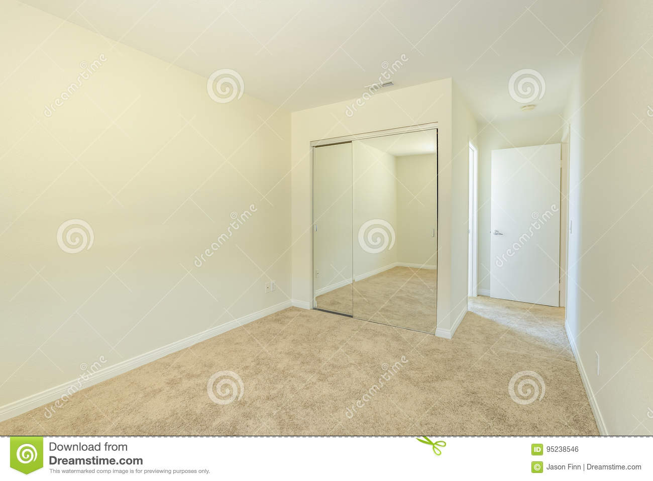 Mirrored Closet Doors In Bedroom In San Diego Apartment Stock Photo