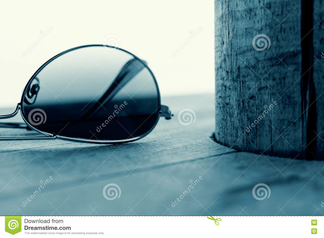 Mirrored Sunglasses Detail on the Wooden Background. Fashion Concept in Cyan.