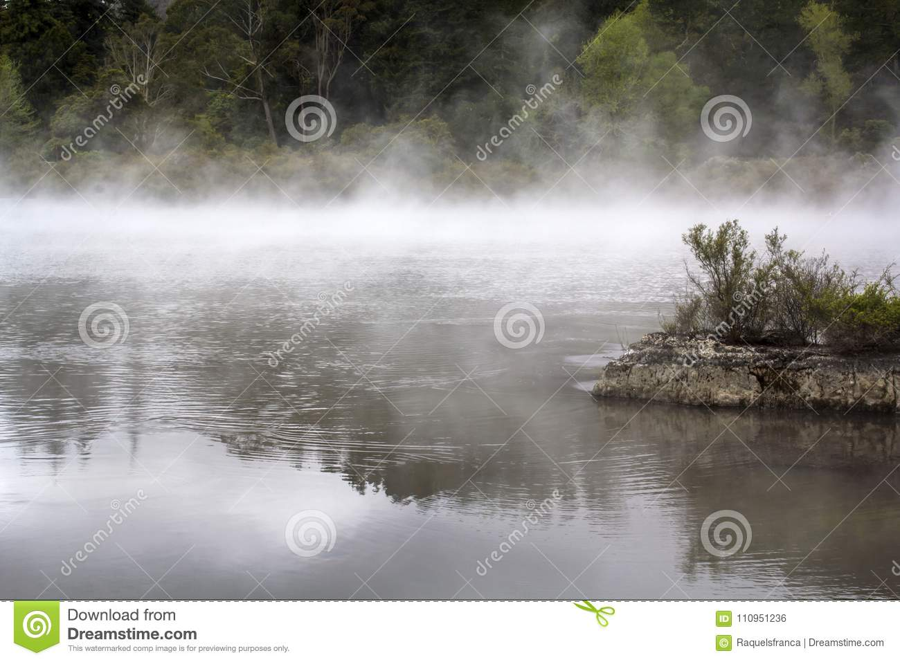 Misty lake magical landscape. Steam rising from hot water