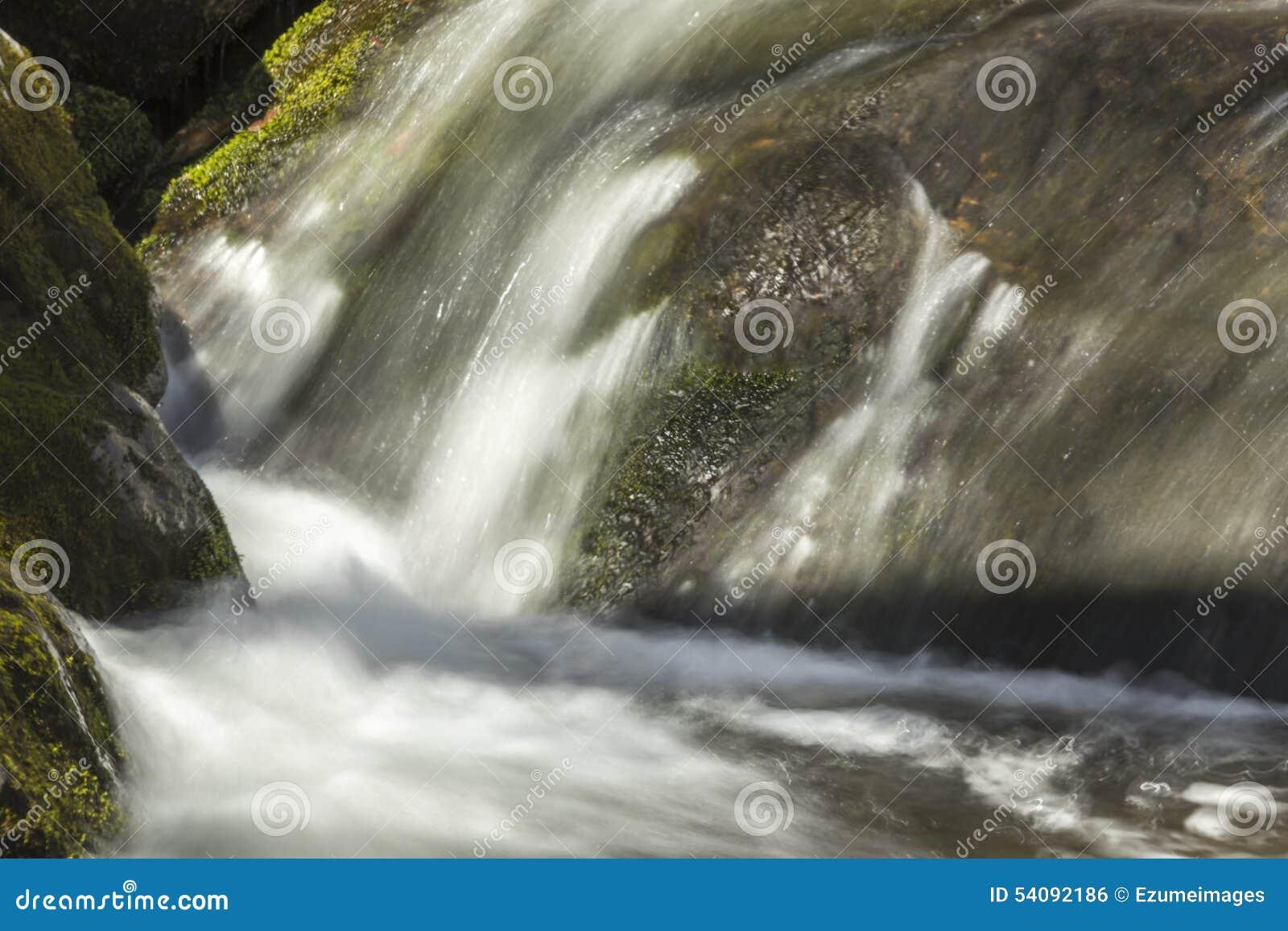 Misty Woodland Waterfall