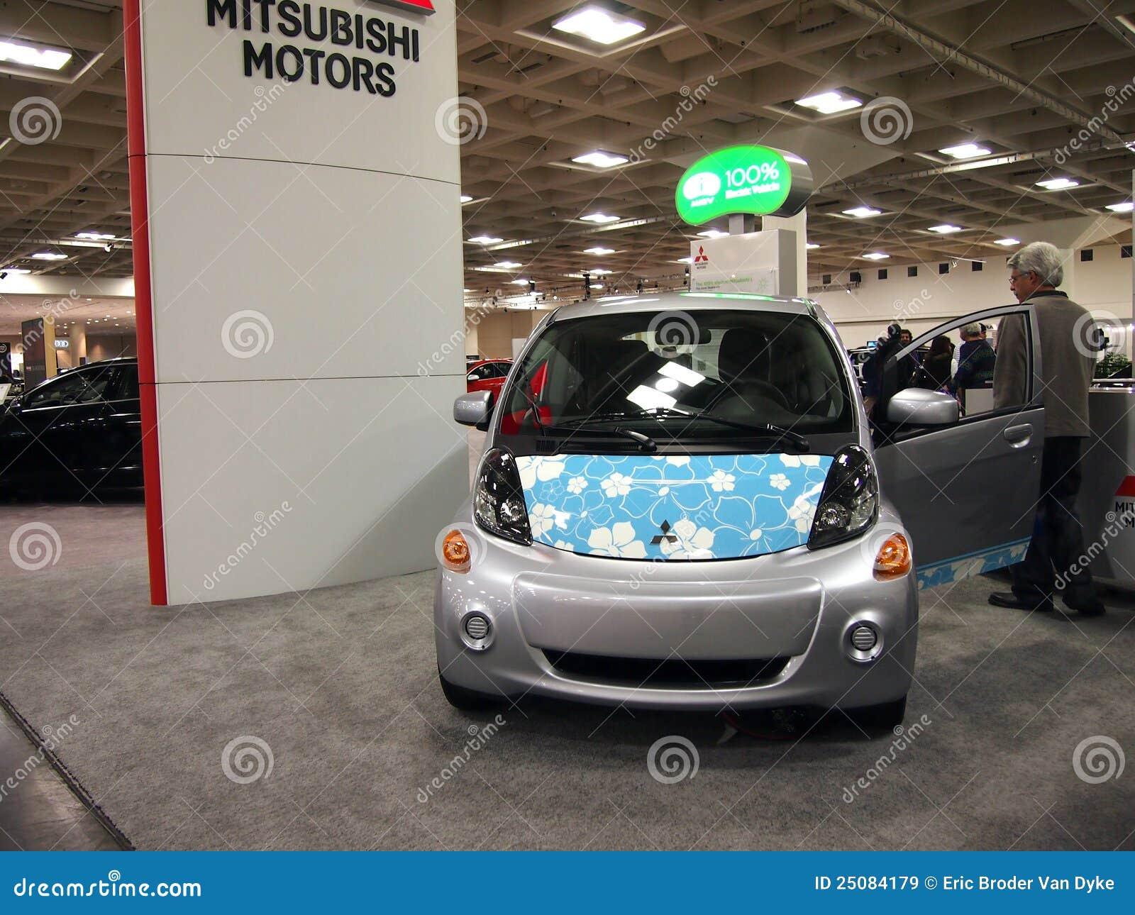 Mitsubishi Motors Company Logo In Front Of Dealership