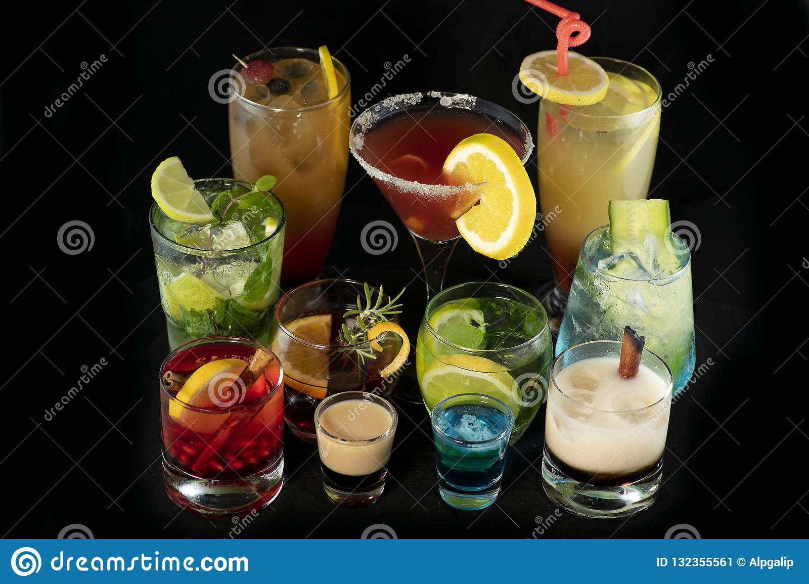 Mix alcoholic cocktails together with isolated black background