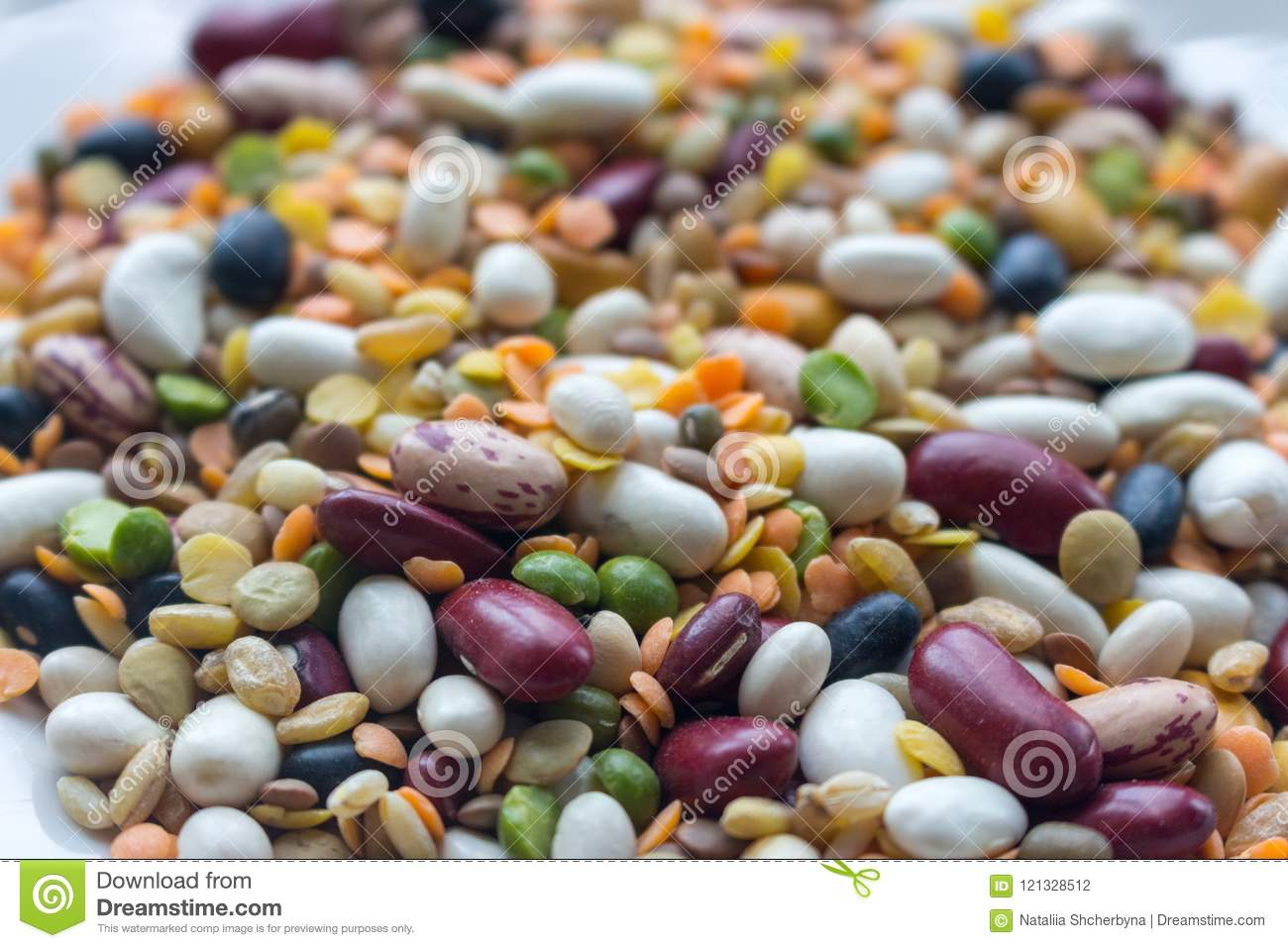 Mix of beans, peas, mung, lentil and kidney beans closeup. Organic healthy food. Mixed beans in perspective.