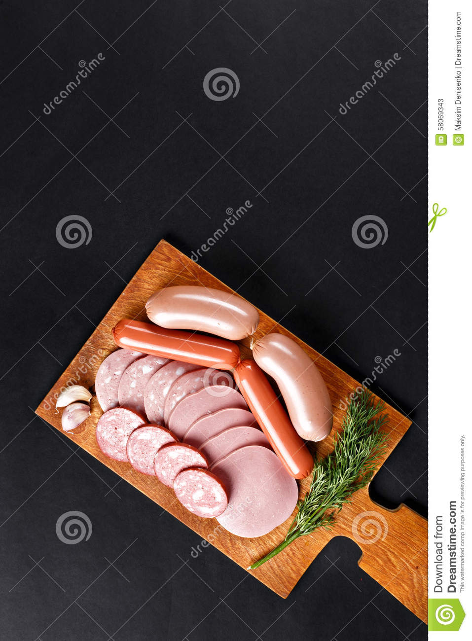 Mix of boiled sausage slices on cutting board